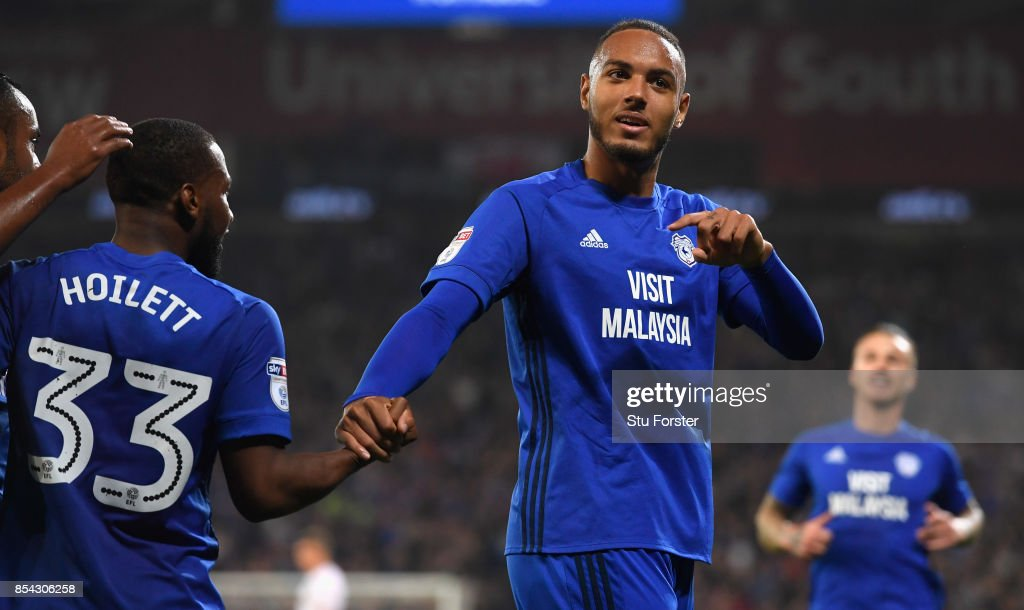 Cardiff player Kenneth Zohore (r) celebrates his first goal with an assist from Junior Hoilett during the Sky Bet Championship match between Cardiff City and Leeds United at Cardiff City Stadium on September 26, 2017 in Cardiff, Wales.