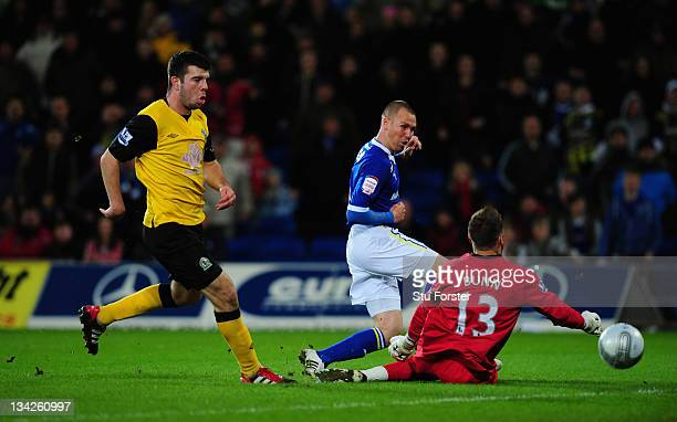 Cardiff player Kenny Miller scores the first goal during the Carling Cup quarter final between Cardiff City and Blackburn Rovers at Cardiff City...