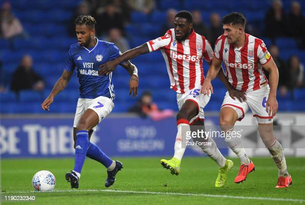 Cardiff player Leandro Bacuna beats Stoke defenders Bruno Martins Indi and Danny Batth to score the opening goal during the Sky Bet Championship...