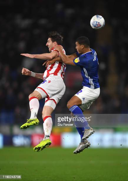 Cardiff player Lee Peltier challenges Stephen Ward of Stoke during the Sky Bet Championship match between Cardiff City and Stoke City at Cardiff City...