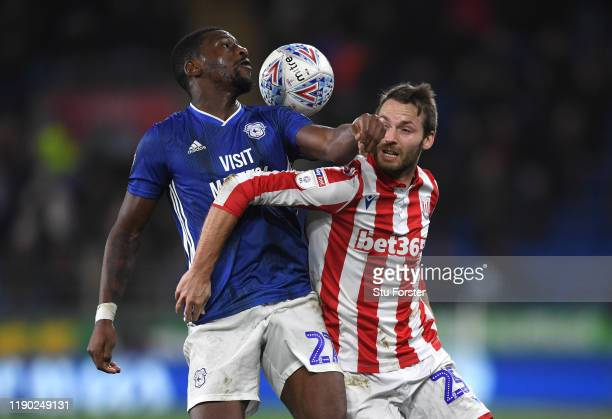 Cardiff player Omar Bogle challenges Nick Powell of Stoke during the Sky Bet Championship match between Cardiff City and Stoke City at Cardiff City...