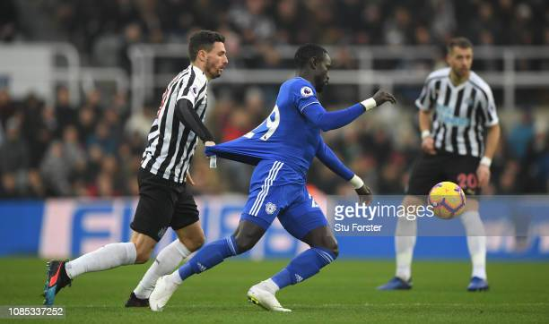 Cardiff player Oumar Niasse has his shirt pulled back by Fabian Schar of Newcastle during the Premier League match between Newcastle United and...