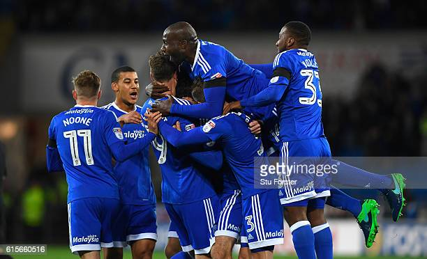 Cardiff player Peter Whittingham is submerged by team mates including Sol Bamba after scoring the opening goal from a free kick during the Sky Bet...
