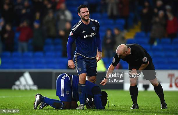 Cardiff player Sean Morrison congratulates Scorer of the third goal Kenwyne Jones as referee Simon Hooper checks on his well being during the Sky Bet...