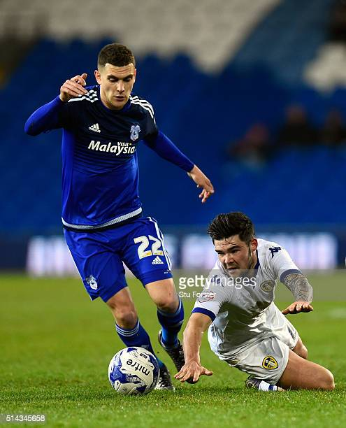 Cardiff player Stuart O' Keefe challenges Leeds player Alex Mowatt during the Sky Bet Championship match between Cardiff City and Leeds United at...