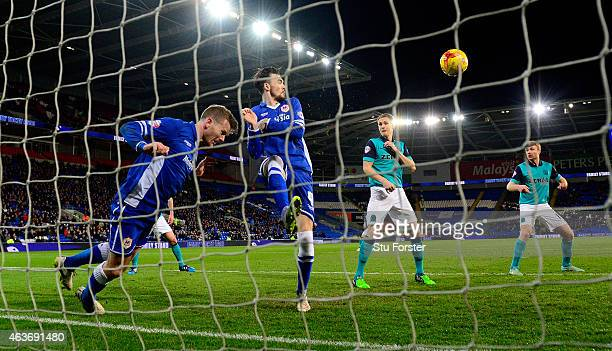 Cardiff players Aron Gunnarsson and Scott Malone combine to clear a Josh King shot off the line during the Sky Bet Championship match between Cardiff...