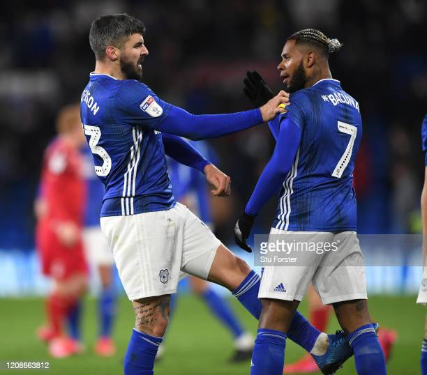 Cardiff players Callum Paterson kicks out at team mate Leandro Bacuna at the final whistle after the Sky Bet Championship match between Cardiff City...