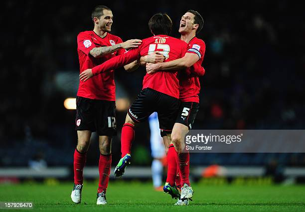 Cardiff players Matthew Connolly and Mark Hudson congratulate Kim Bo-Kyung on his goal during the npower Championship match between Blackburn Rovers...