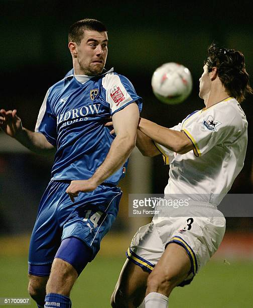 Cardiff striker Alan Lee challenges Dejan Stefanovic for the ball during The Carling Cup 4th round between Cardiff City and Portsmouth at Ninian Park...