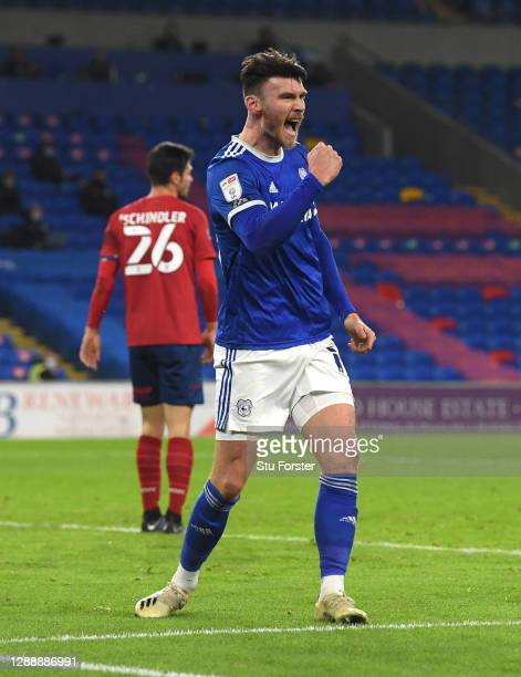Cardiff striker Kieffer Moore celebrates after scoring the opening goal during the Sky Bet Championship match between Cardiff City and Huddersfield...