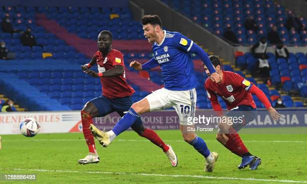 Cardiff striker Kieffer Moore shoots to score the opening goal during the Sky Bet Championship match between Cardiff City and Huddersfield Town at...