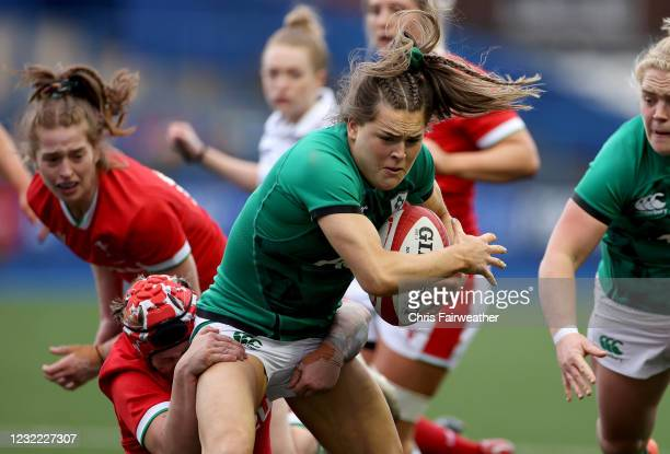 Cardiff , United Kingdom - 10 April 2021; Beibhinn Parsons of Ireland is tackled by Donna Rose of Wales during the Women's Six Nations Rugby...