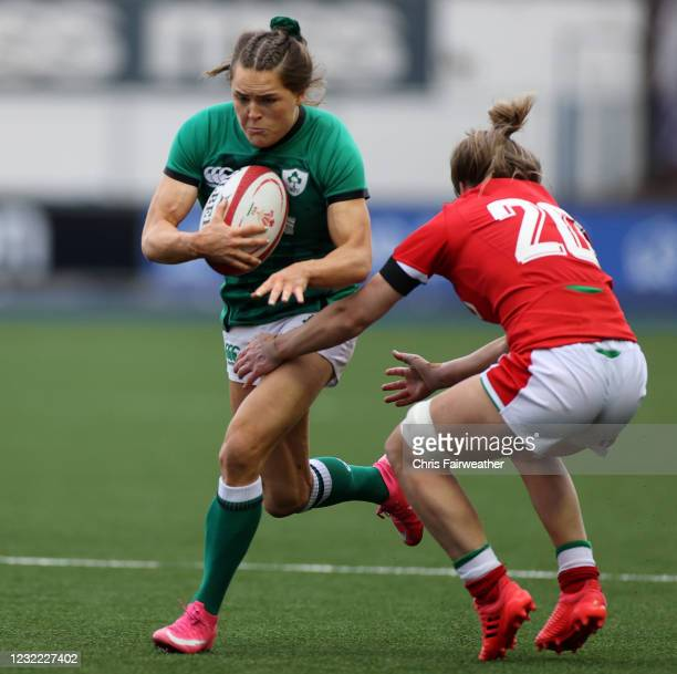 Cardiff , United Kingdom - 10 April 2021; Beibhinn Parsons of Ireland is tackled by Bethan Dainton of Wales during the Women's Six Nations Rugby...