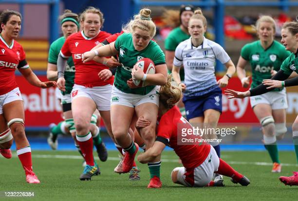 Cardiff , United Kingdom - 10 April 2021; Cliodhna Moloney of Ireland is tackled by Manon Johnes of Wales during the Women's Six Nations Rugby...