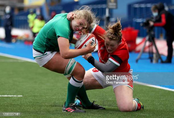 Cardiff , United Kingdom - 10 April 2021; Dorothy Wall of Ireland is tackled by Caryl Thomas of Wales on her way to scoring a try during the Women's...