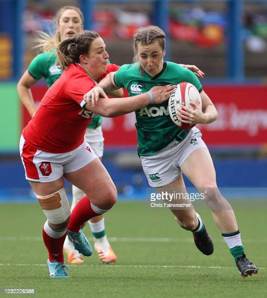 Cardiff , United Kingdom - 10 April 2021; Eve Higgins of Ireland is tackled by Siwan Lillicrap of Wales during the Women's Six Nations Rugby...