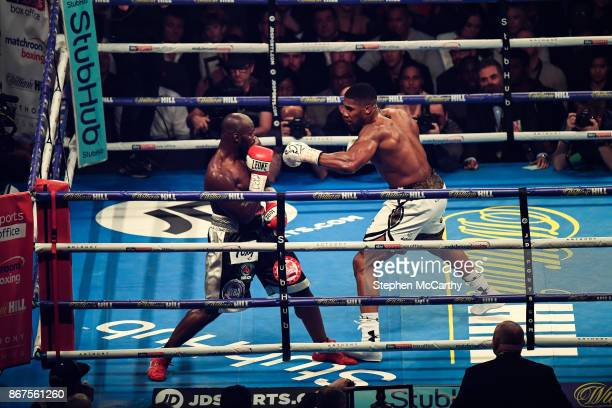 Cardiff United Kingdom 28 October 2017 Anthony Joshua right and Carlos Takam during their World Heavyweight Title fight at the Principality Stadium...