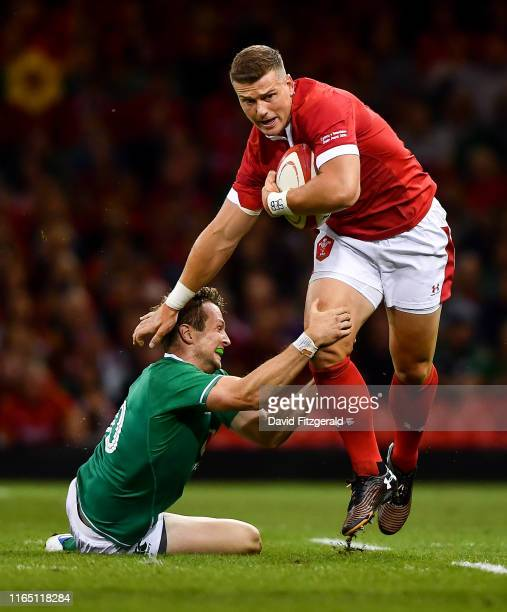 Cardiff United Kingdom 31 August 2019 Scott Williams of Wales is tackled by Jack Carty of Ireland during the Under Armour Summer Series 2019 match...