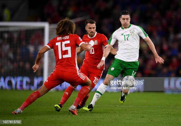 Cardiff United Kingdom 6 September 2018 Stephen Ward of Republic of Ireland in action against Tom Lawrence and Aaron Ramsey of Wales during the UEFA...