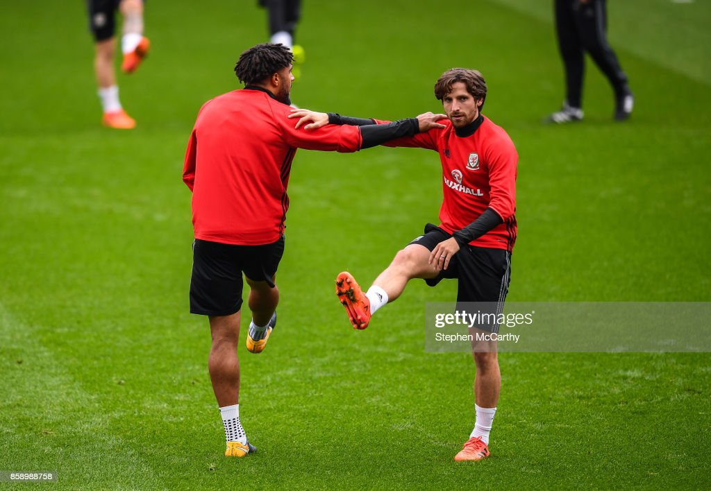 Cardiff , United Kingdom - 8 October 2017; Joe Allen, right, and Ashley Williams of Wales during squad training at Cardiff City Stadium in Cardiff, Wales.