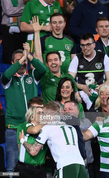 Cardiff United Kingdom 9 October 2017 James McClean of Republic of Ireland celebrates his side's victory with his wife Erin following the FIFA World...