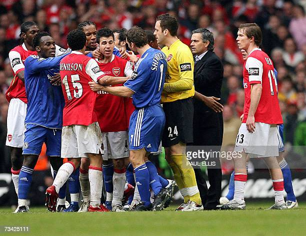 Chelsea manager Jose Mourinho enters the field to help stop a fight between his players and Arsenal's during the English League Cup Final football...