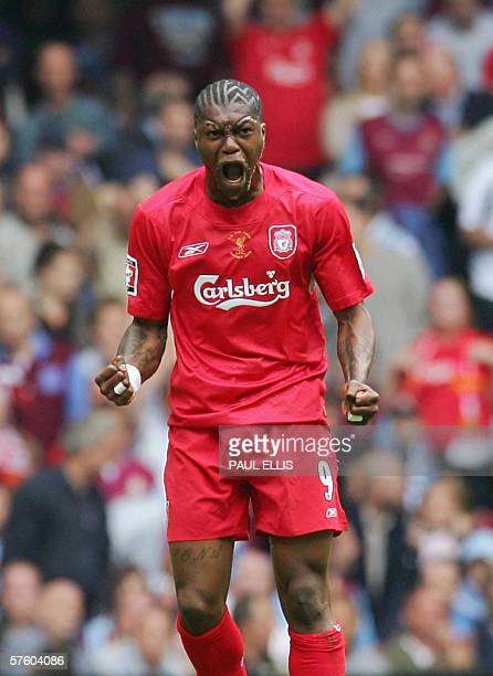 Cardiff, UNITED KINGDOM: correcting spelling in first name Liverpool's Djibril Cisse celebrates after scoring his team's first goal against West Ham...
