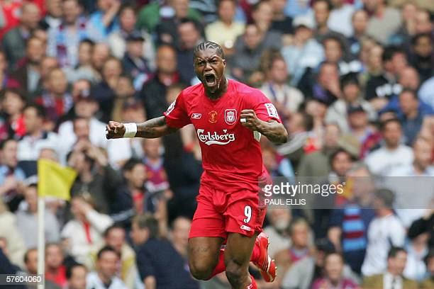 Cardiff, UNITED KINGDOM: Correcting spelling of first name Liverpool's Djibril Cisse celebrates after scoring his team's first goal against West Ham...