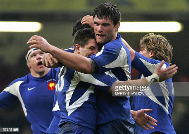 France's captain Fabien Pelous celebrates with his players as the final whistle blows in the 6 Nations championship rugby match against Wales 18...