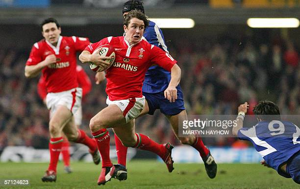 Cardiff, UNITED KINGDOM: France's scrum half Dimitri Yachvili fails to stop Wales' winger Shane Williams who sets up his side for a try during their...