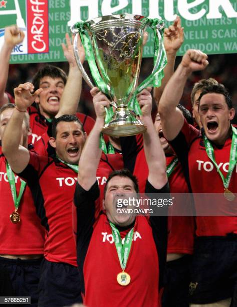 Munster captain Anthony Foley holds the Heineken Cup European final trophy aloft at the Millennium Stadium in Cardiff 20 May 2006Irish team Munster...