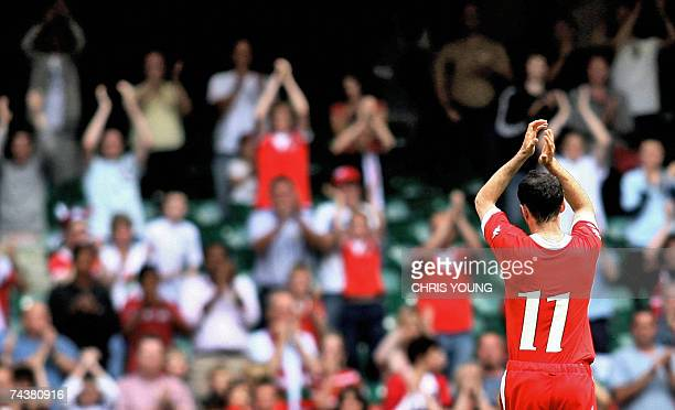 Wales' skipper Ryan Giggs acknowledges the crowd's applause as he is substituted and retires from international football during Euro 2008 qualifying...