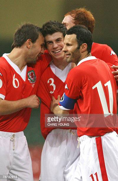Welsh defender Gareth Bale celebrates scoring his side's second goal with teammates Carl Fletcher and Ryan Giggs during their Euro 2008 qualifying...