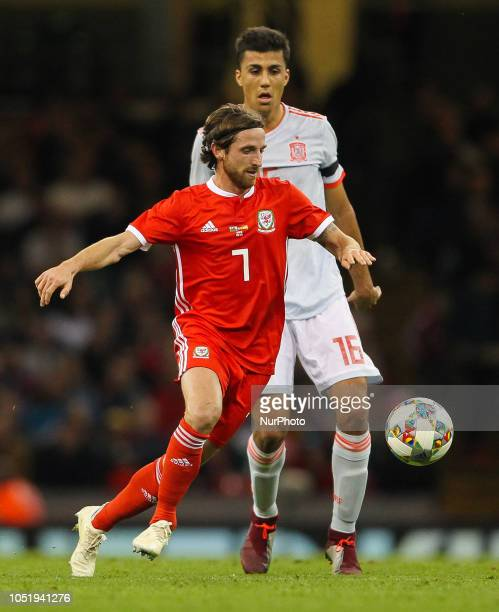Cardiff Wales October 11 2018 Joe Allen of Wales controls the ball despite the pressure from Rodri of Spain during Exhibition Match between Wales and...