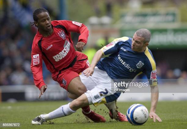 Cardiff's Kevin McNaughton and Ipswich Town's Jaime Peters battle for the ball during the CocaCola Championship match at Ninian Park Cardiff Wales