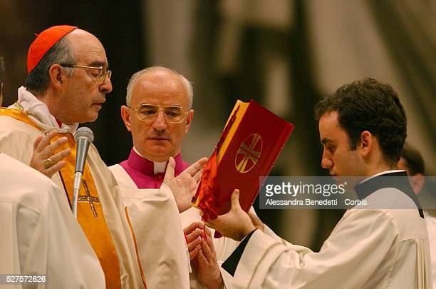Cardinal Alfonso Lopez Trujillo presides the ritual of the washing of the feet during the Mass of the Lord's Supper in St Peter Basilica replacing...
