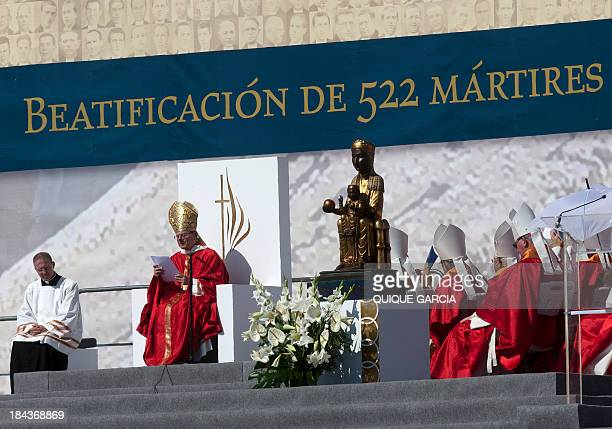 Cardinal Angelo Amato representing Pope Francis conducts an open air mass during a beatification ceremony in the eastern city of Tarragona on October...