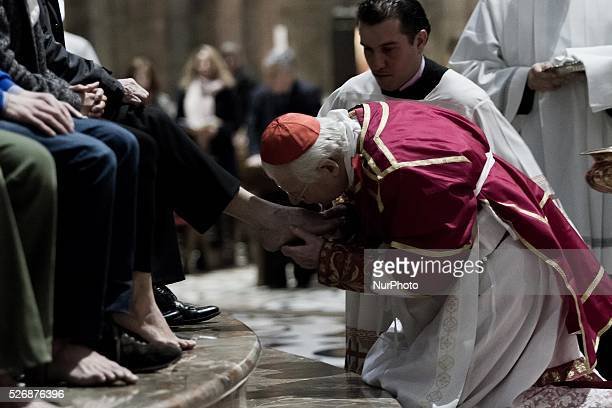 Cardinal Angelo Scola during washing of the feet celebrating Maundy Thursday in Milan on 24th March 2016