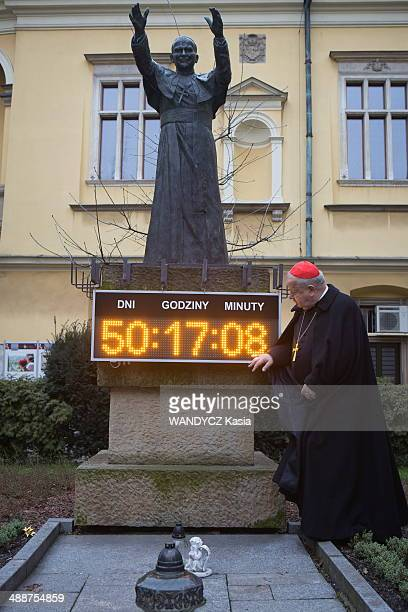 Cardinal Archbishop of Krakow Stanislaw Dziwisz poses in front the statue of JeanPaul II on March 07 2014 in Krakow Poland