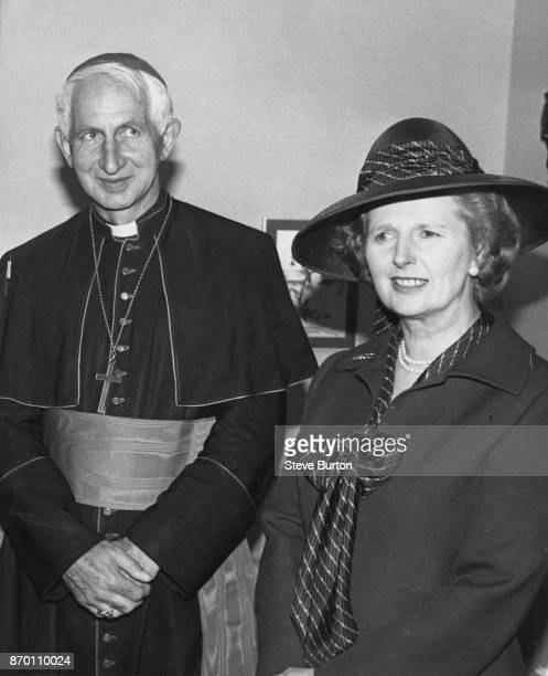 Cardinal Basil Hume Archbishop of Westminster with British Prime Minister Margaret Thatcher after holding a mass to celebrate the Diamond Jubilee of...