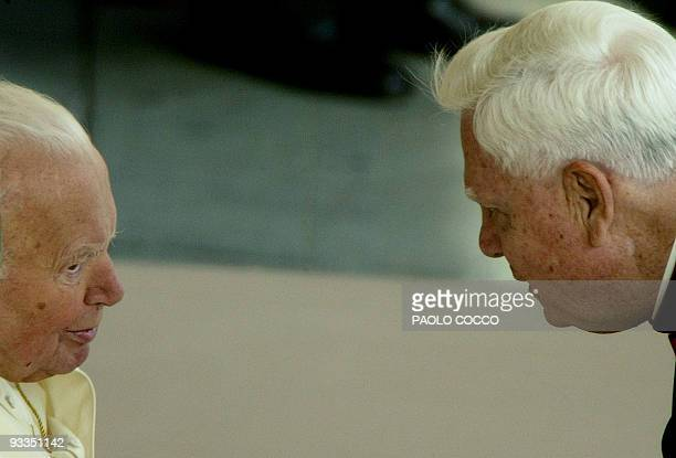 US Cardinal Bernard Law who recently resigned as Archbishop of Boston talks with Pope John Paul II at the end of the weekly's general audience in St...
