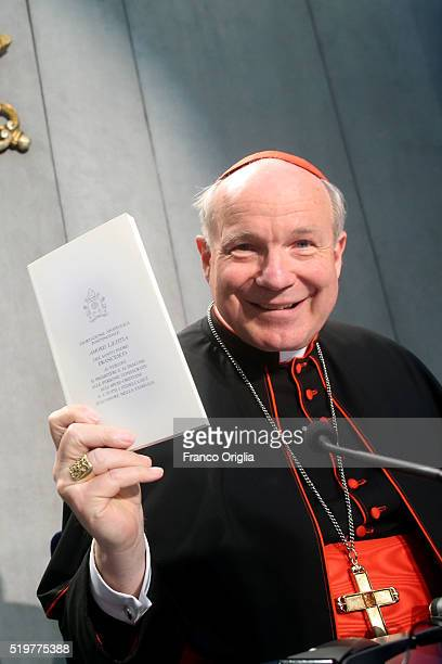 Cardinal Christoph Schonborn holds a copy of Pope Francis' post-synodal Apostolic Exhortation 'Amoris Laetitia' or 'The Joy of Love' at the Holy See...