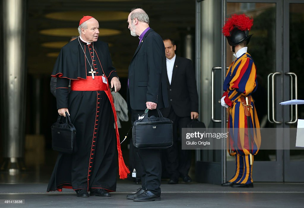 Cardinal Christoph Schonborn (L) leaves the opening session of the Synod on the themes of family at Synod Hall on October 5, 2015 in Vatican City, Vatican. The main themes of this Synod of Bishops are 'The vocation and mission of the family in the Church and the contemporary world'.