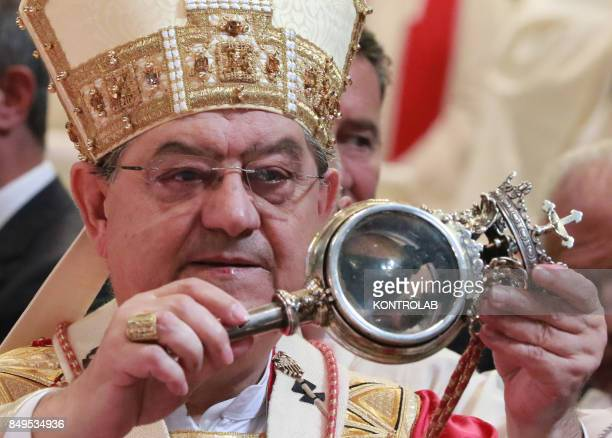 Cardinal Crescenzio Sepe the Archbishop of Naples shows the ampoule with the liquefied blood during the ceremony for the solemnity of San Gennaro The...