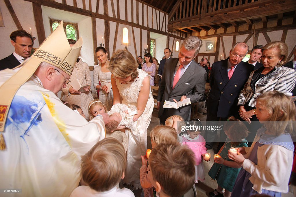 Cardinal Danneels, Count Sebastien von Westphalen, Princess Claire of Belgium, Princess Victoria of Sweden, Princess Mathilde carrying Princess Eeonore, Prince Philippe of Belgium, King Albert and Queen Paola from Belgium assisted by young children participate in the baptism of Princess Eleonore in the Chapel of Ciergnon Castle on June 14, 2008 in Ciergnon, Belgium.