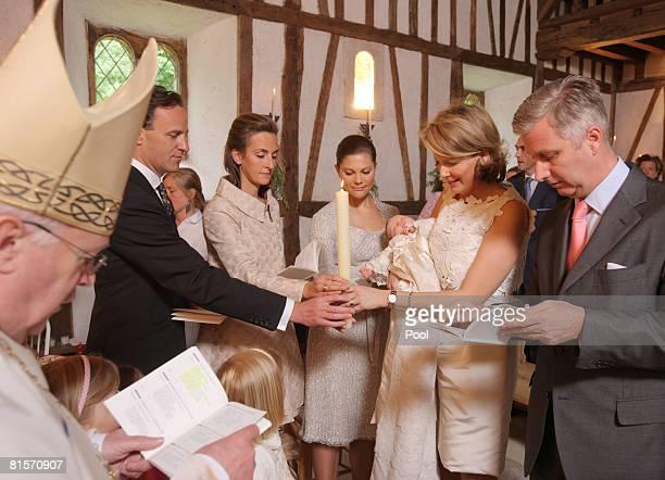 Cardinal Danneels Count Sebastien von Westphalen Princess Victoria of Sweden Princess Mathilde of Belgium holding Princess Eleonore of Belgium and...