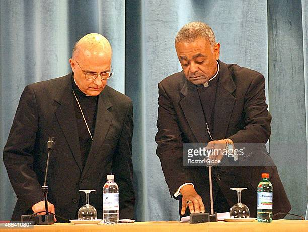 Cardinal Francis E George from Chicago and Bishop Wilton Gregory president of the US Conference of Bishops prepare to ready for start of press...