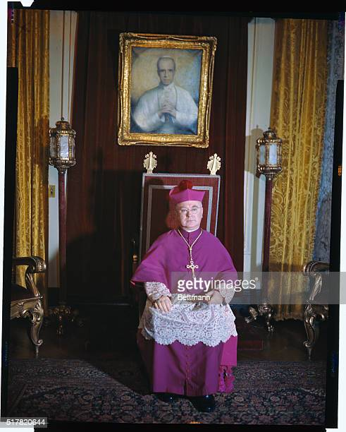 Cardinal Francis Spellman is shown in this seated fulllength portrait