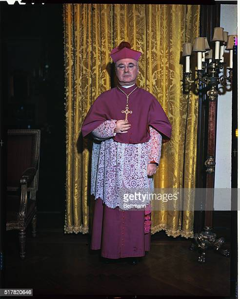 Cardinal Francis Spellman is shown standing in this fulllength portrait
