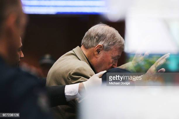 Cardinal George Pell is searched by a security guard after he arrives at Melbourne Magistrates' Court on March 5 2018 in Melbourne Australia Cardinal...